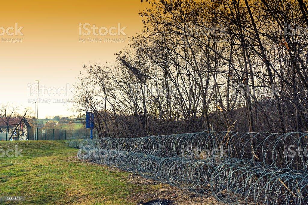 Razor wire Wormhole against refugees stock photo