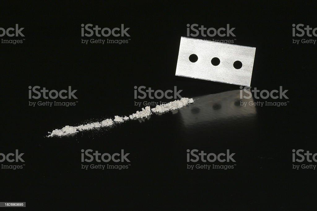 Razorblade and cocaine stock photo