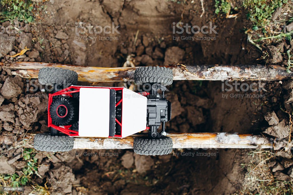 Rc car above yawner on logs top view stock photo