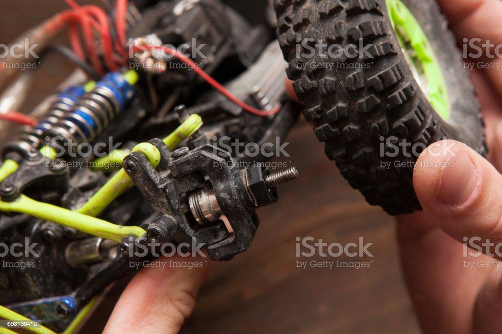 Rc car model toy wheel repair stock photo