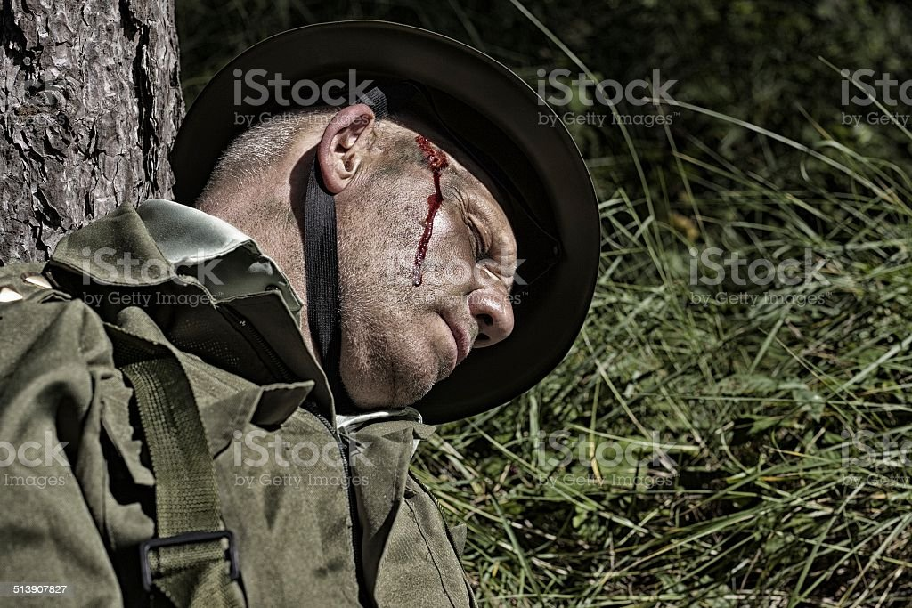 re enactment of  soldier with a bullet wound to head stock photo