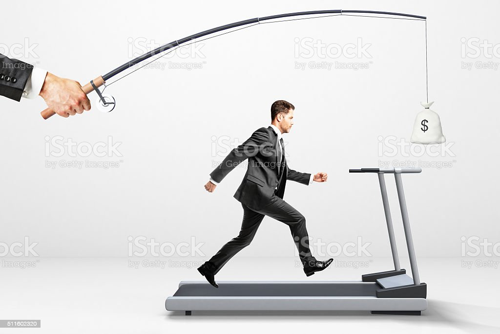 Reach a goal concept with businessman running stock photo