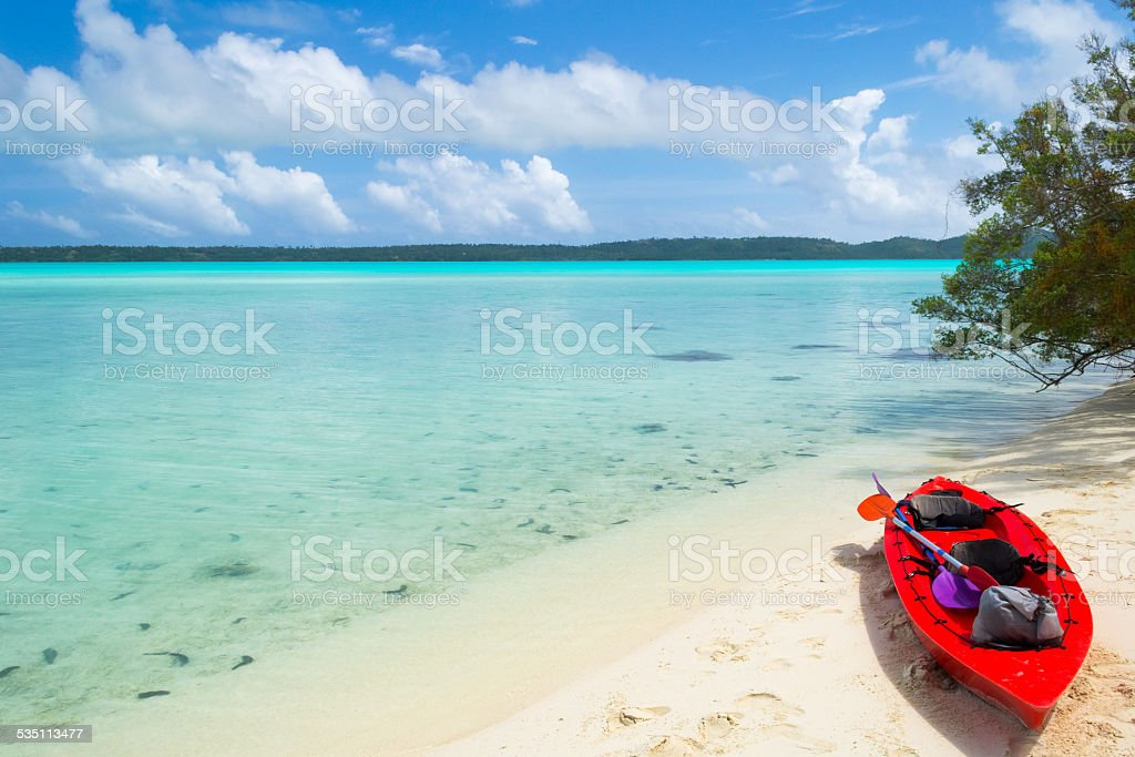 Reaching a desert island by canoeing stock photo