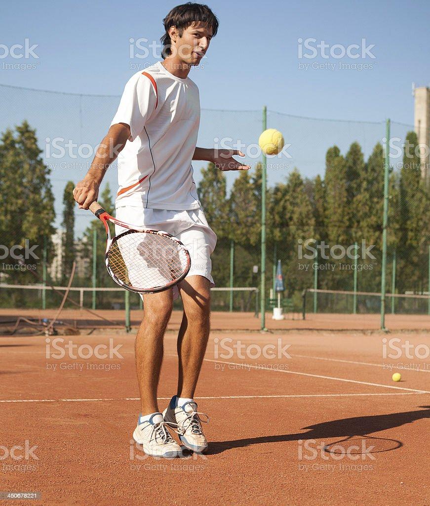 reaching a short ball royalty-free stock photo