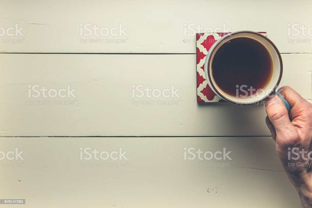 Reaching for a coffee stock photo