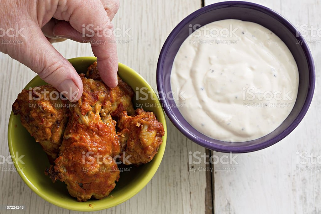 Reaching For A Hot Wing stock photo