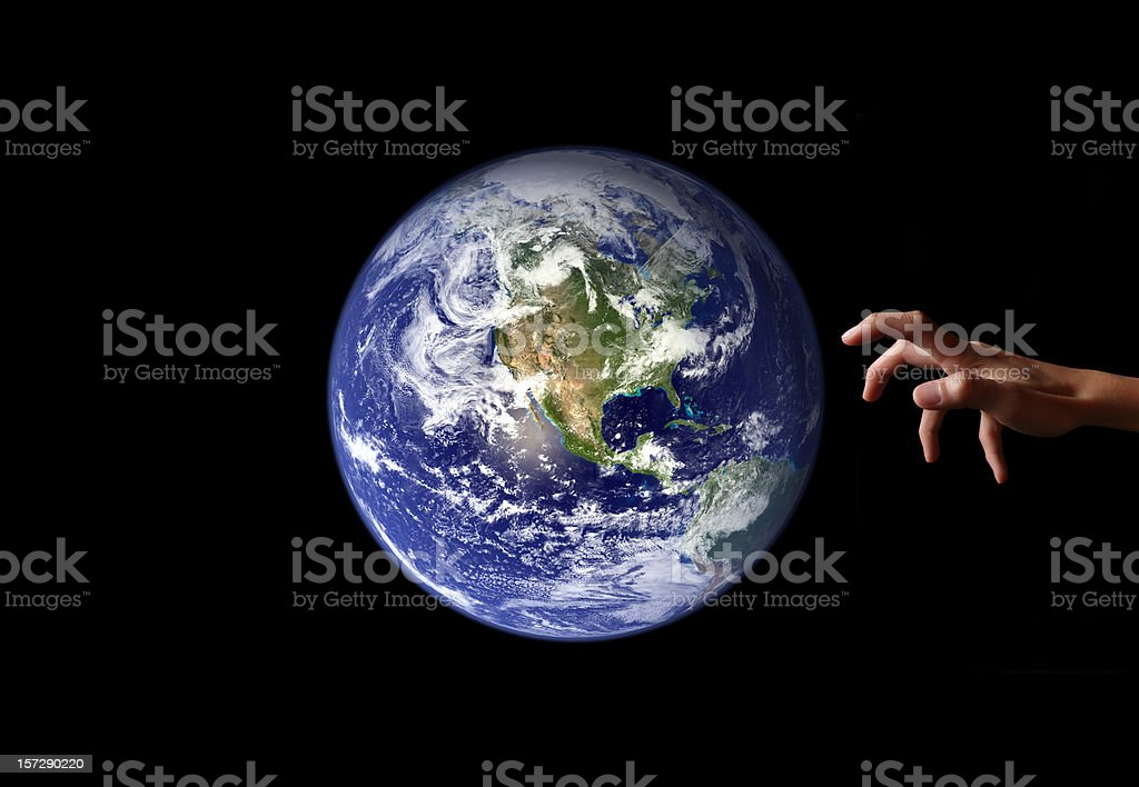 Reaching for Earth stock photo