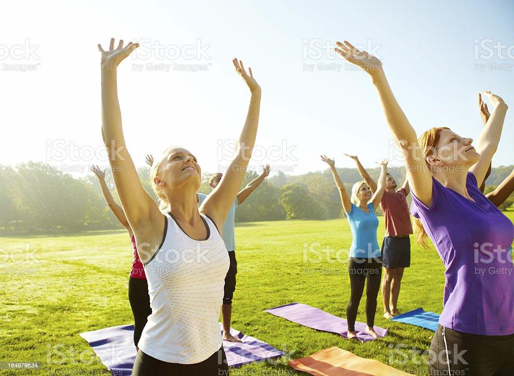 Reaching for good health - Yoga royalty-free stock photo