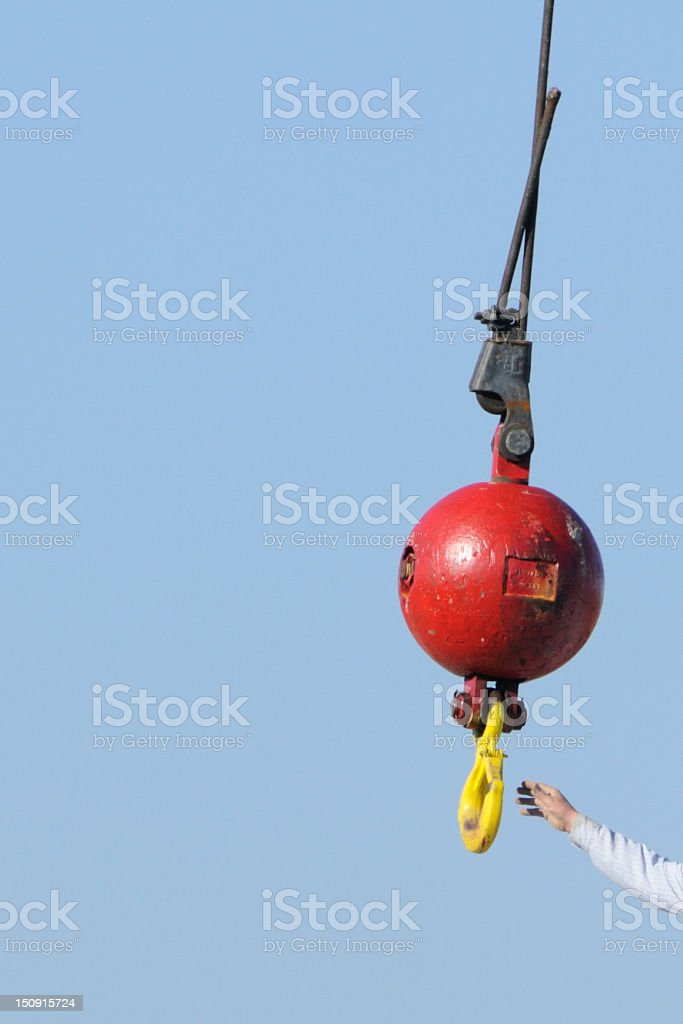 Reaching for the  ball and hook stock photo