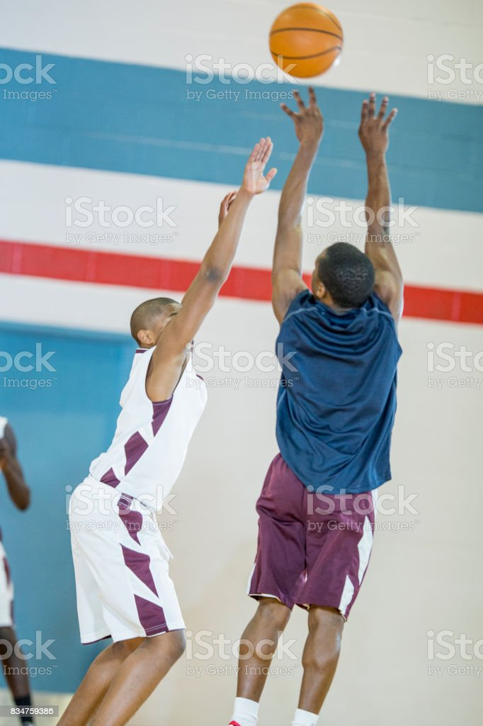 Reaching For The Ball stock photo