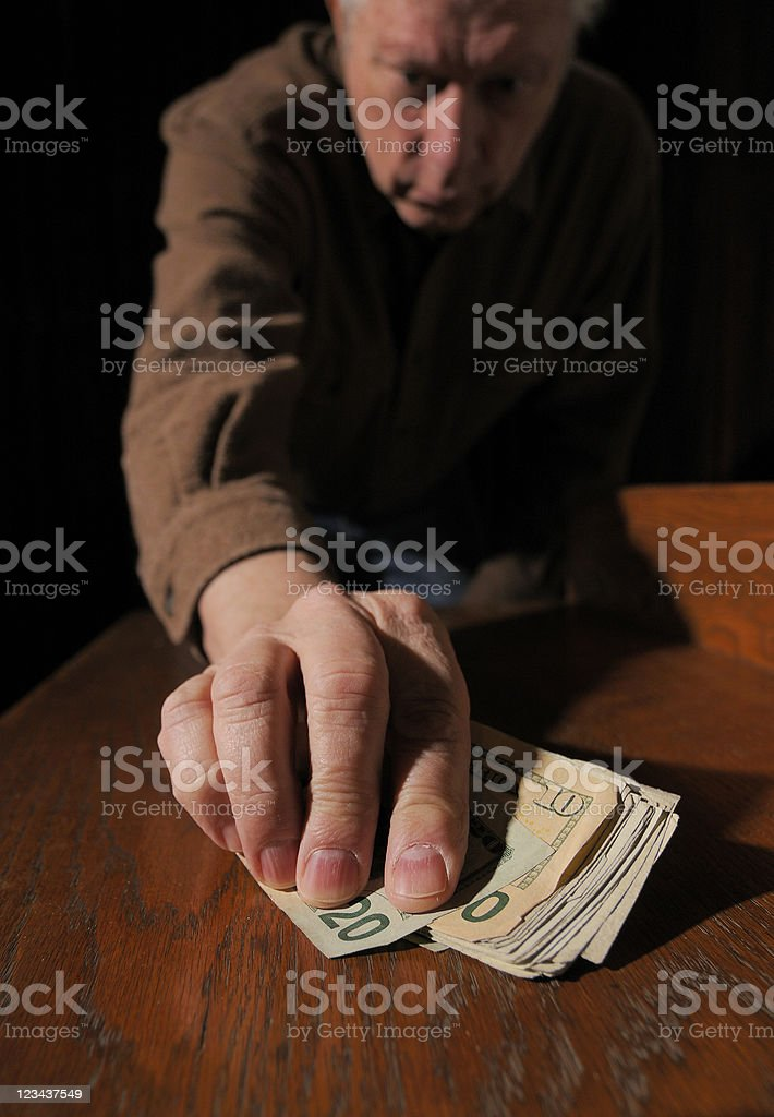 Reaching for the Cash royalty-free stock photo