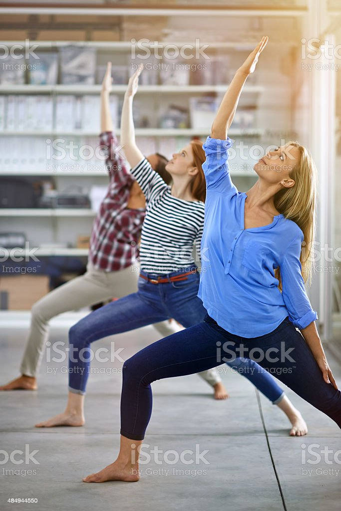 Reaching for their goals stock photo