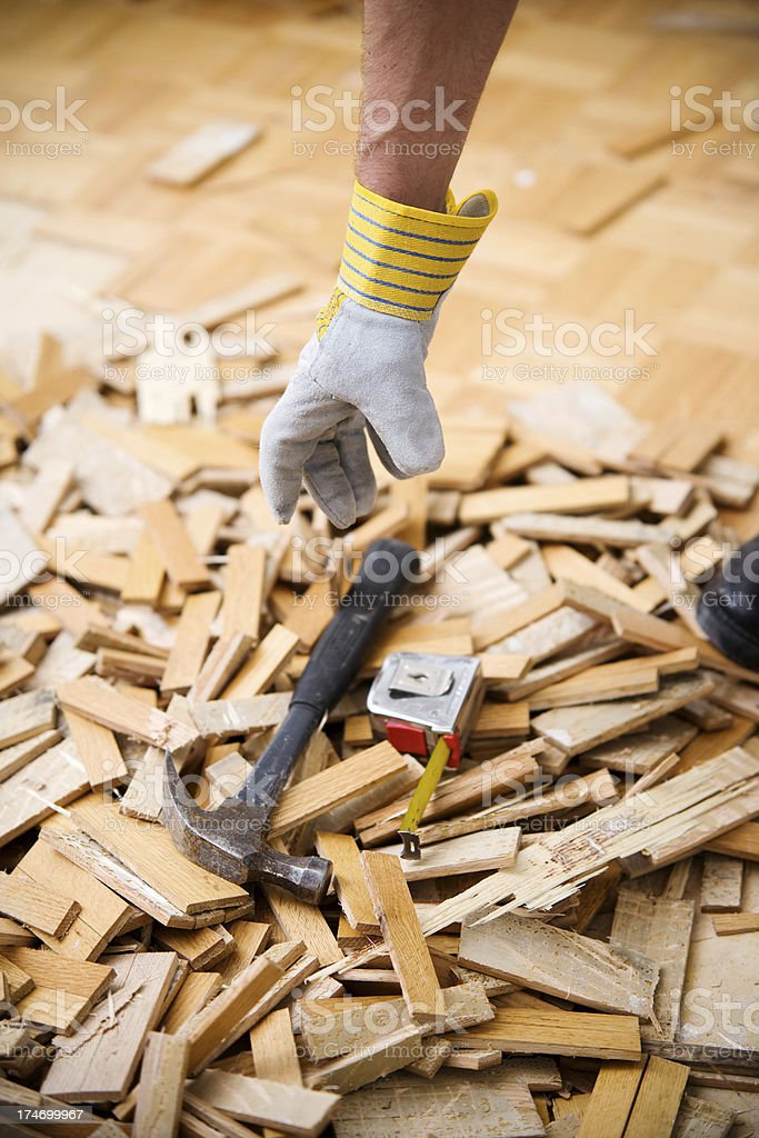 Reaching for Tools in Pile of Wood Background royalty-free stock photo