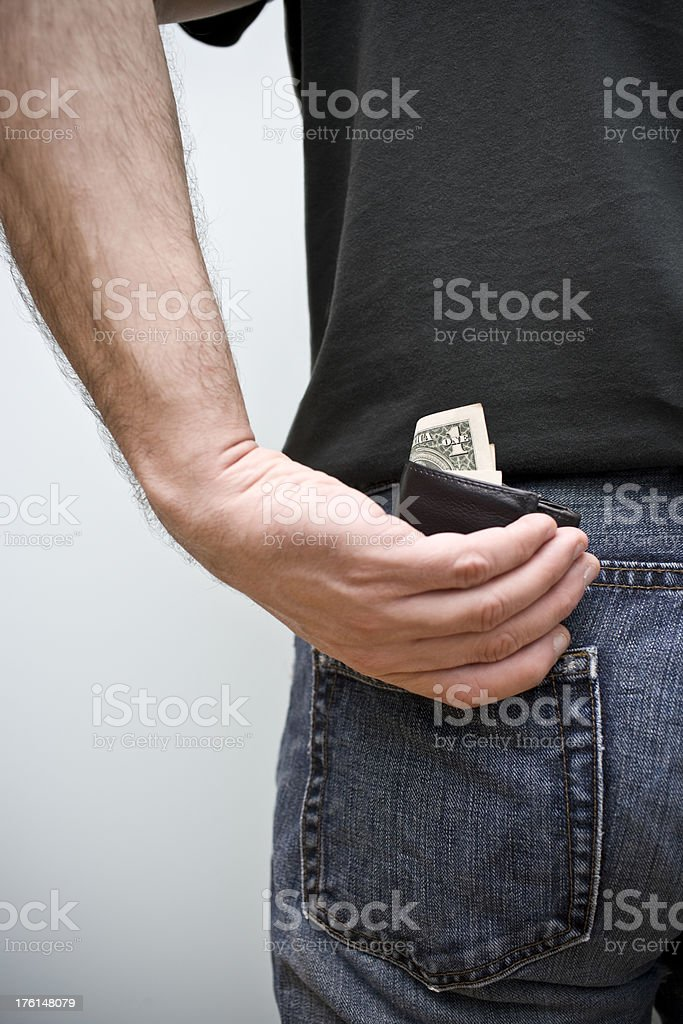 Reaching for Wallet stock photo
