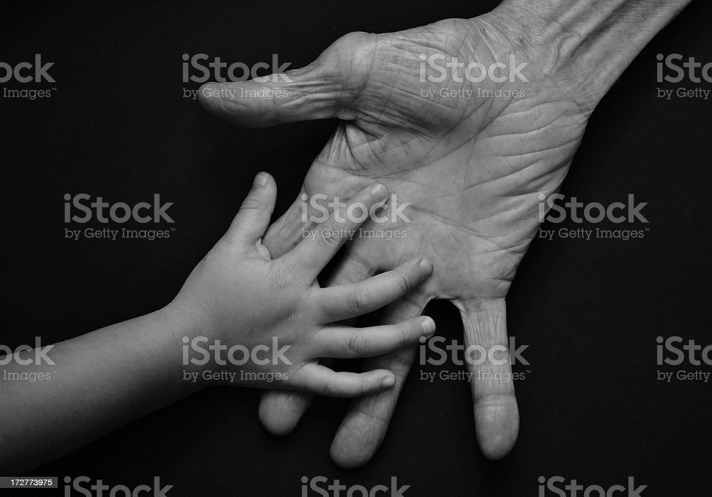 reaching hands stock photo
