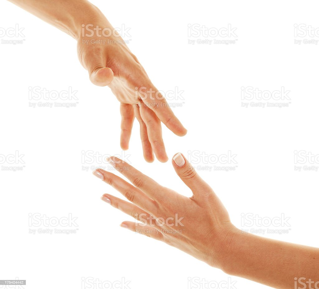 Reaching hands royalty-free stock photo