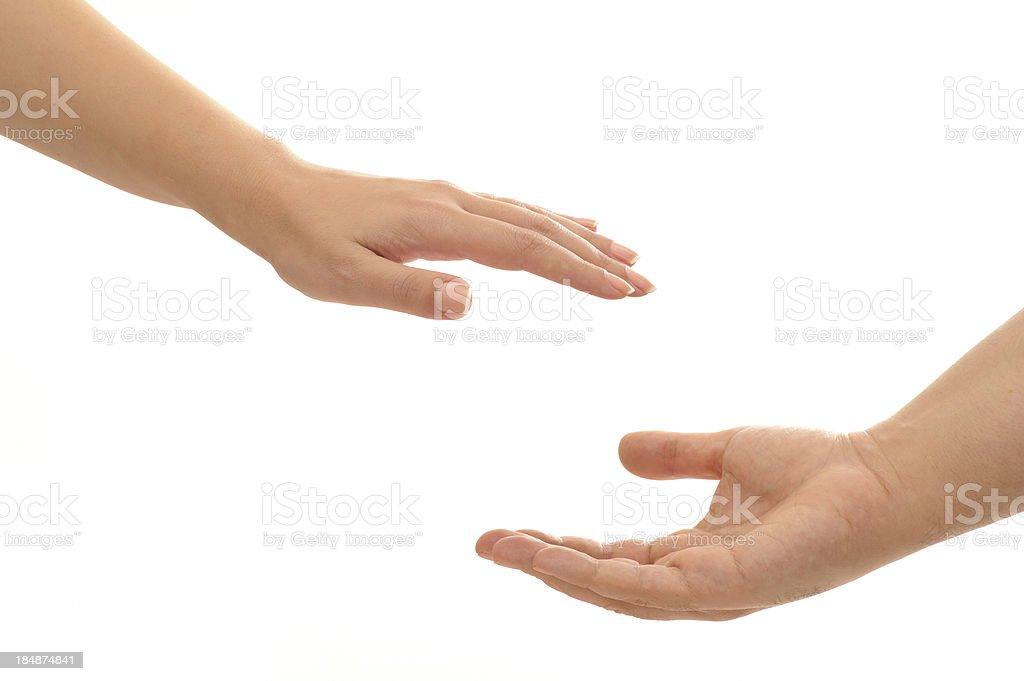 Reaching hands stock photo