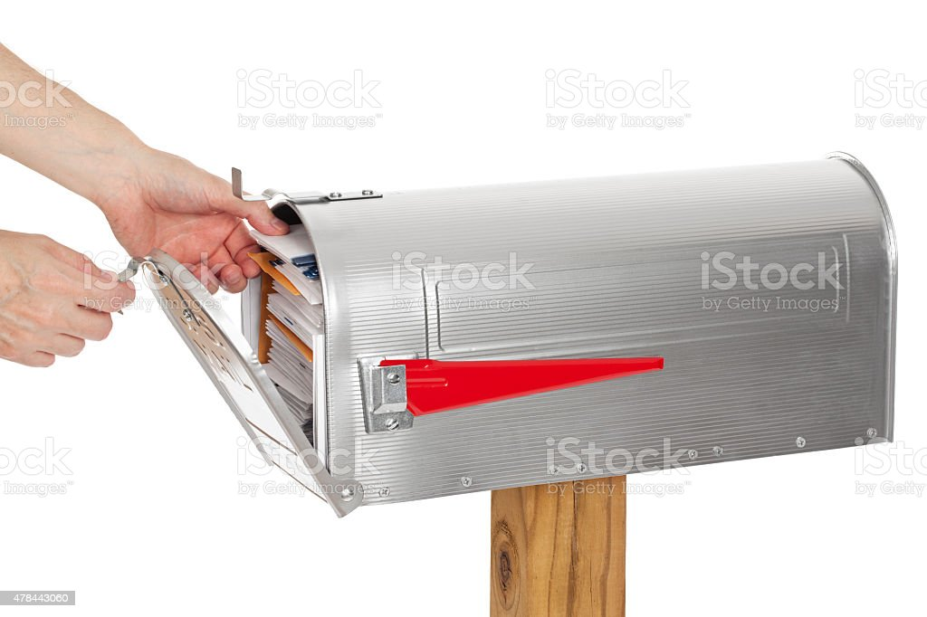 Reaching Into A Full Mailbox To Get The Mail stock photo