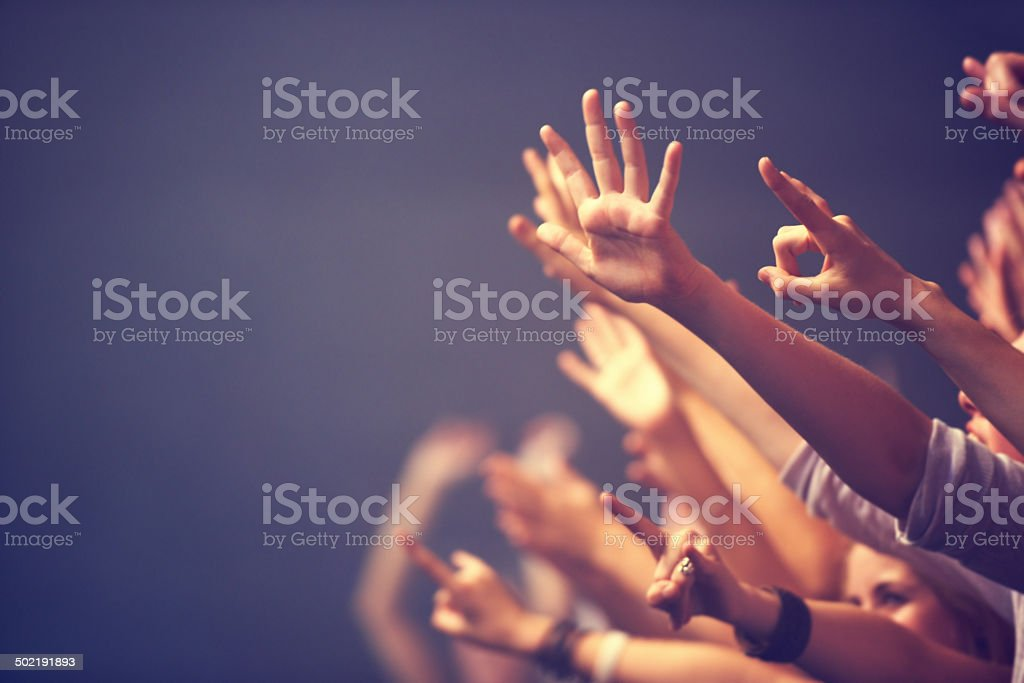 Reaching out in adulation stock photo