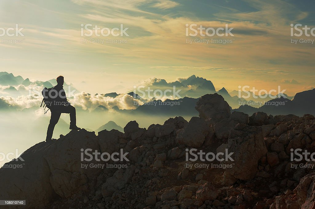 Reaching the mountain peak stock photo