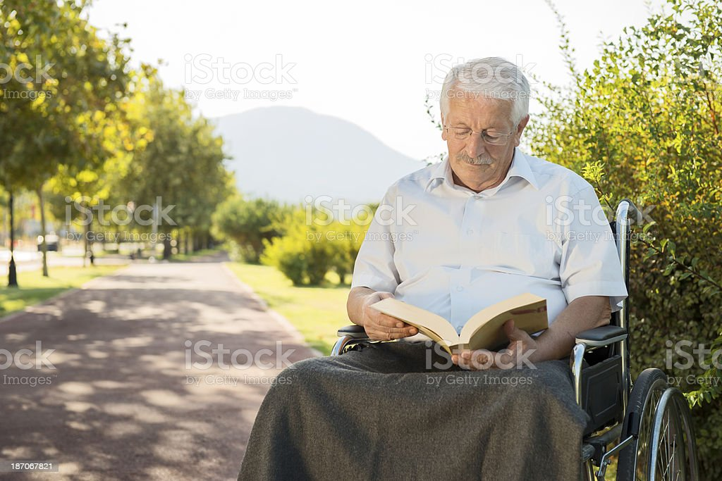 read a book with disabilities royalty-free stock photo