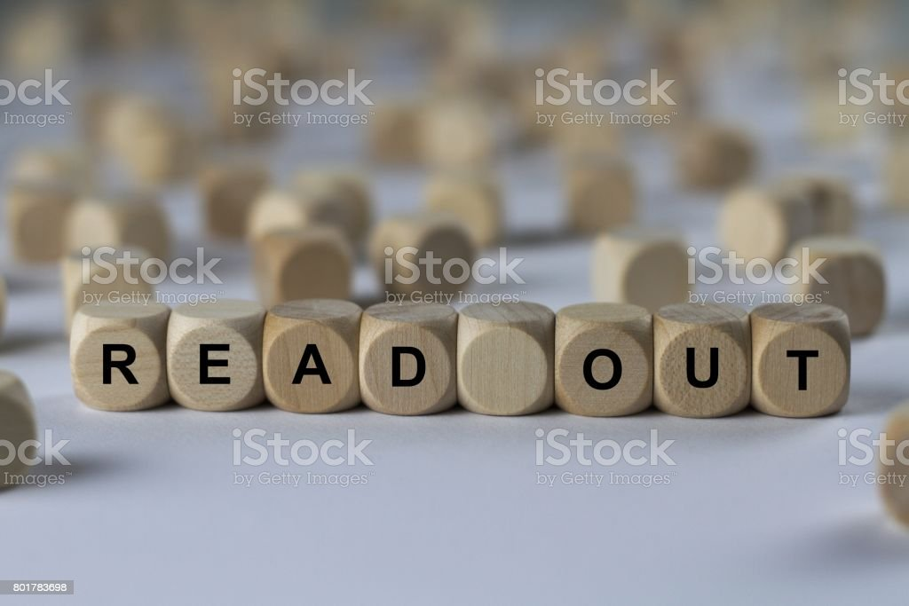 read out - cube with letters, sign with wooden cubes stock photo