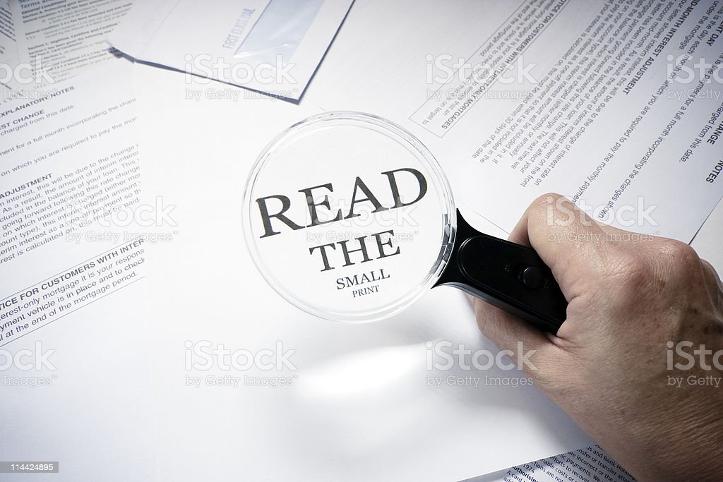 read the small print stock photo