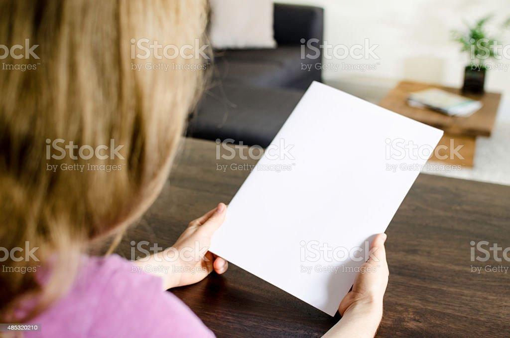 Reading a blank magazin stock photo