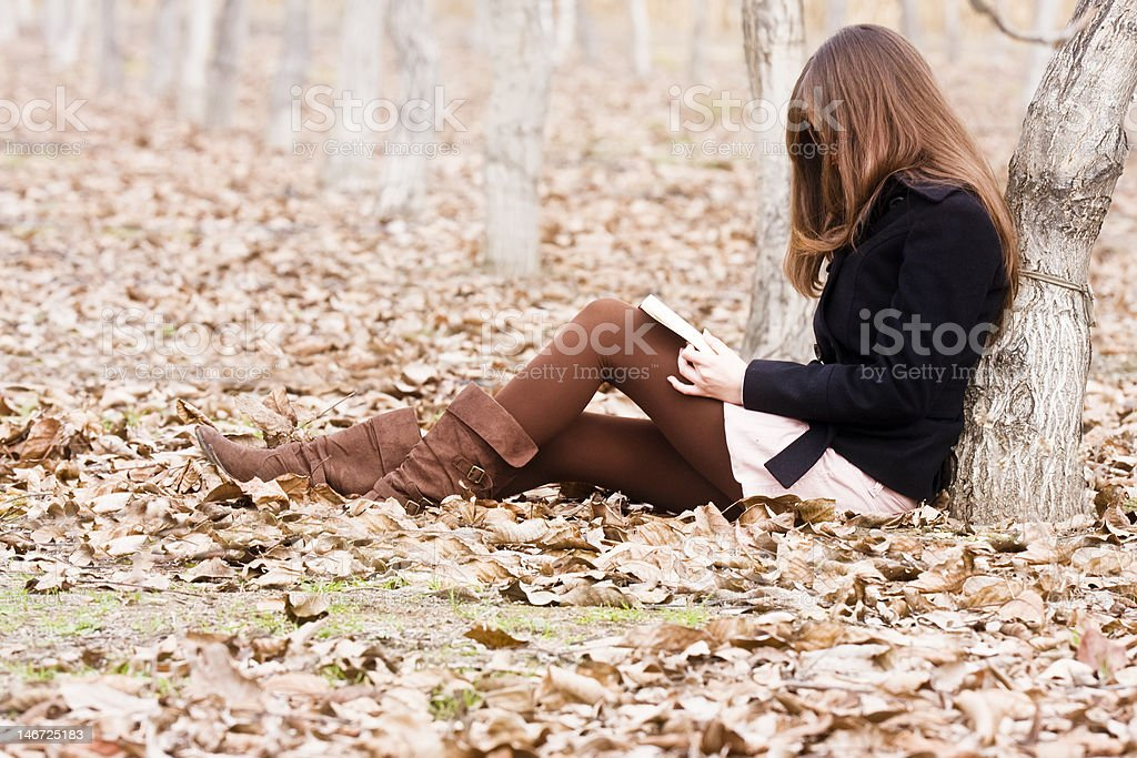 Reading a book in the forest royalty-free stock photo