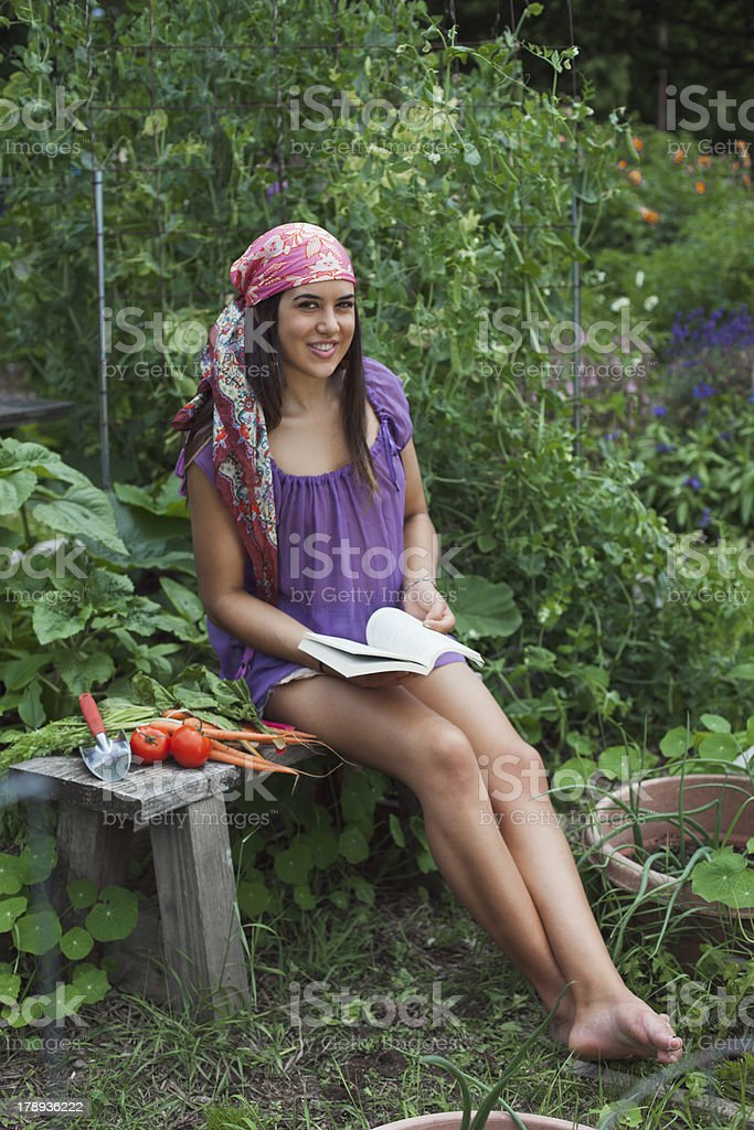 Reading a book in the Garden royalty-free stock photo