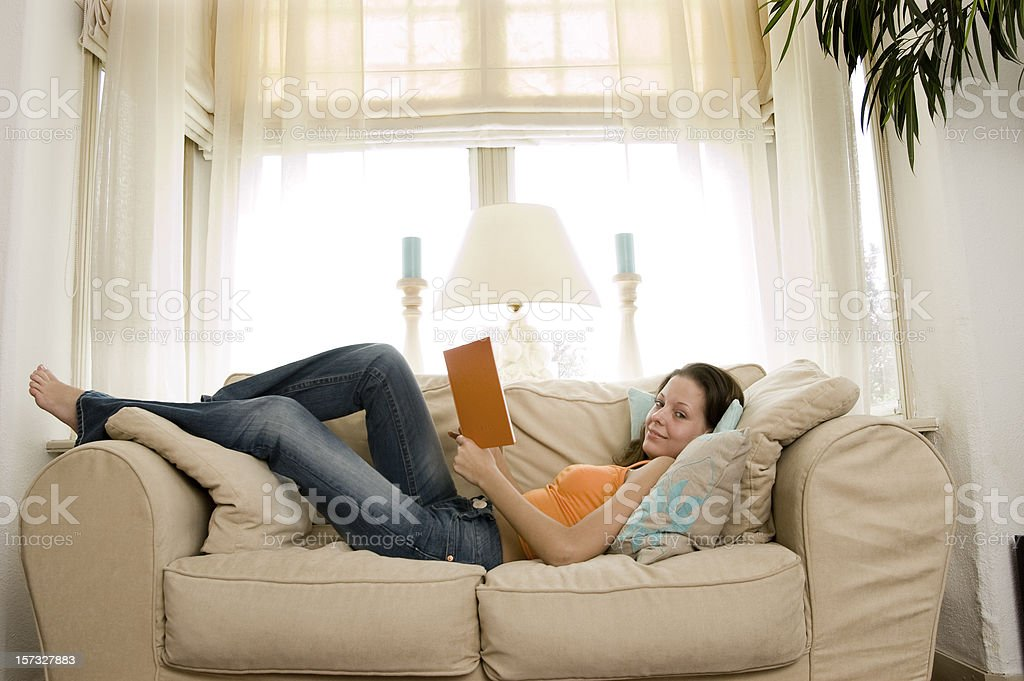 reading a book on the sofa royalty-free stock photo