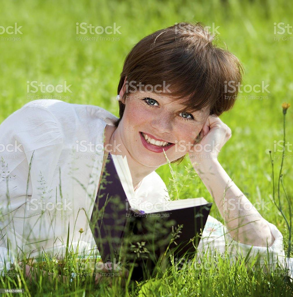 reading a book outdoor stock photo