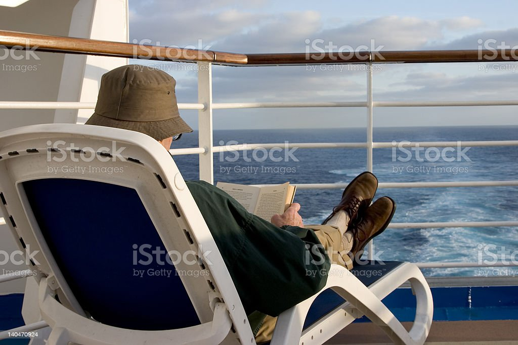 Reading a book while cruising royalty-free stock photo