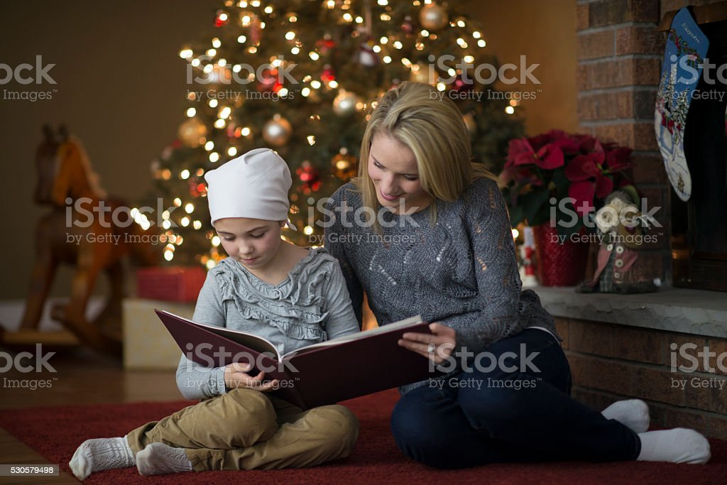 Reading a Christmas Book Together stock photo