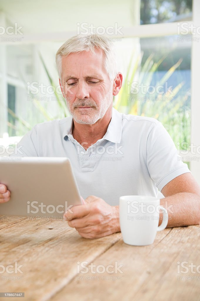 Reading a digital tablet royalty-free stock photo