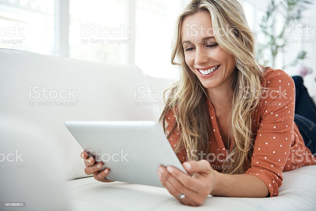 Reading a funny post stock photo