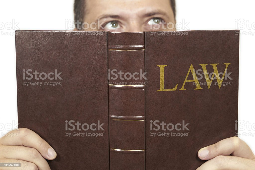 Reading a law book stock photo