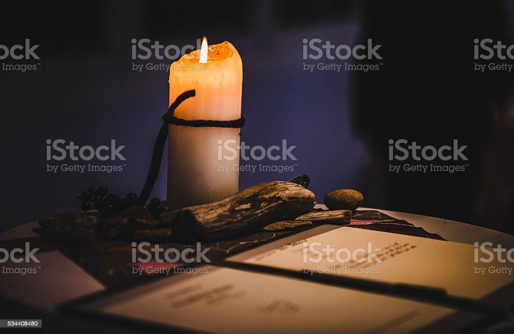 Reading a letter by candle light stock photo
