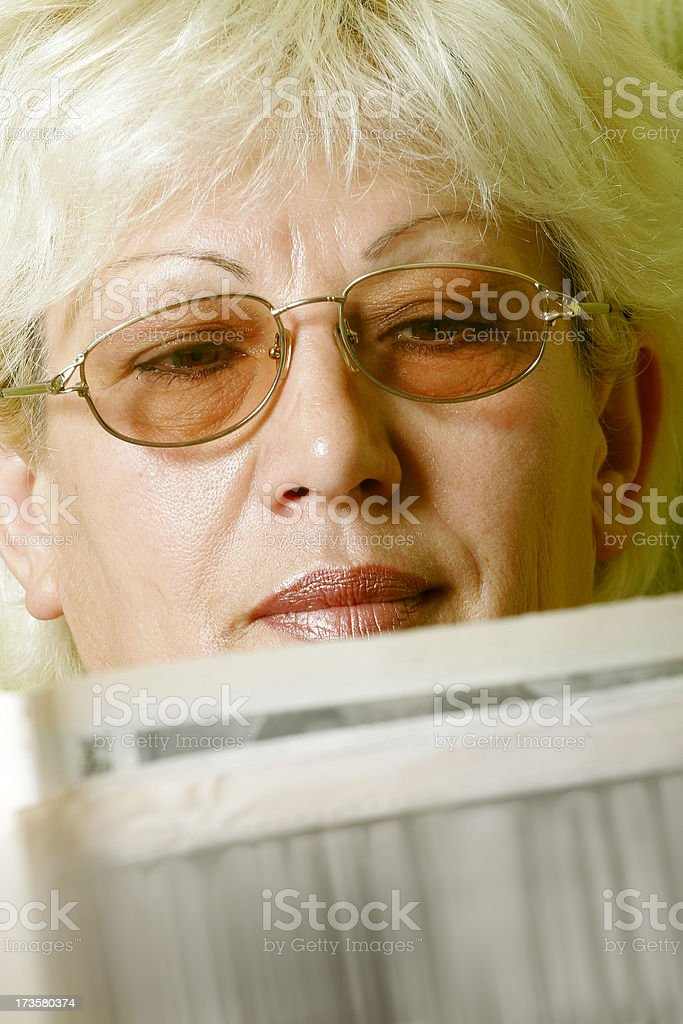 Reading a newspaper royalty-free stock photo