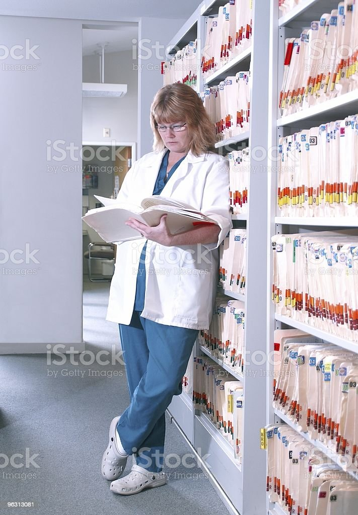 Reading A Patient's Chart royalty-free stock photo
