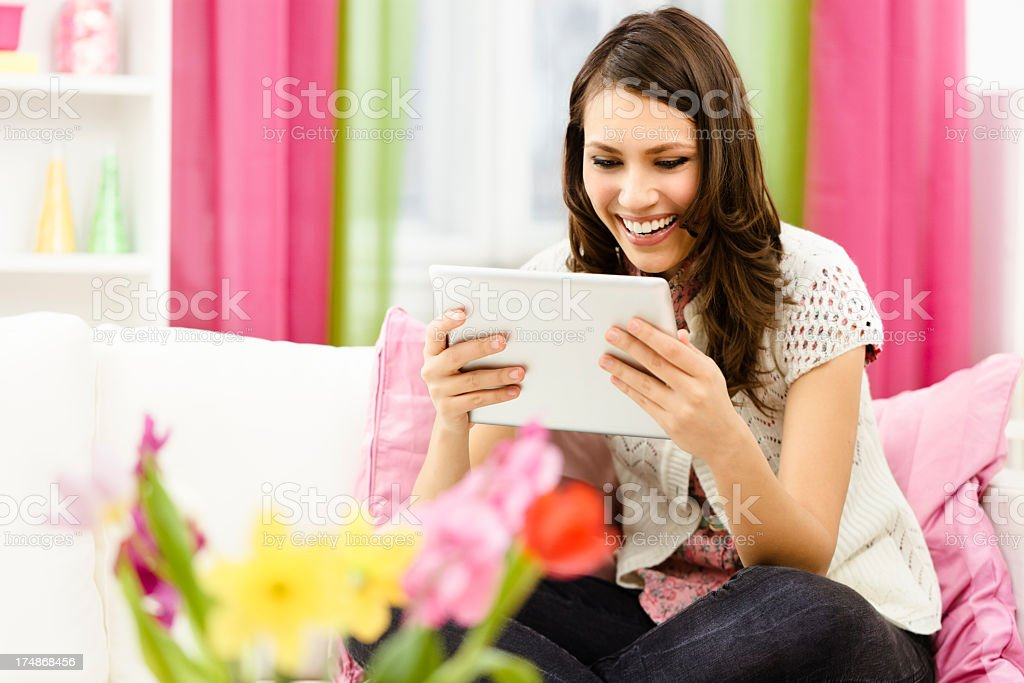 Reading a tablet royalty-free stock photo