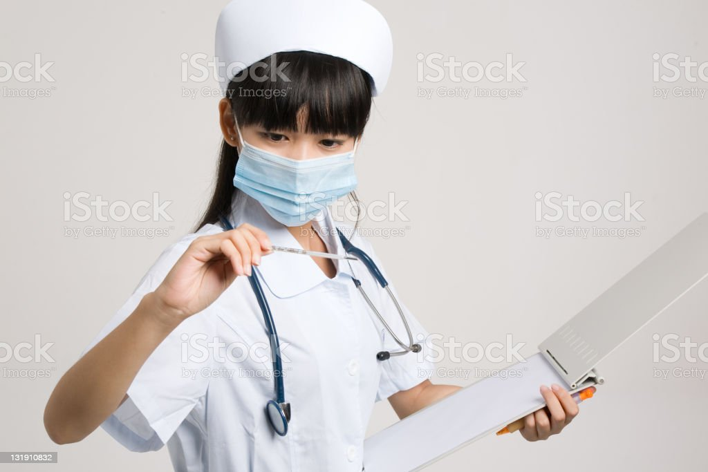 Reading a thermometer royalty-free stock photo