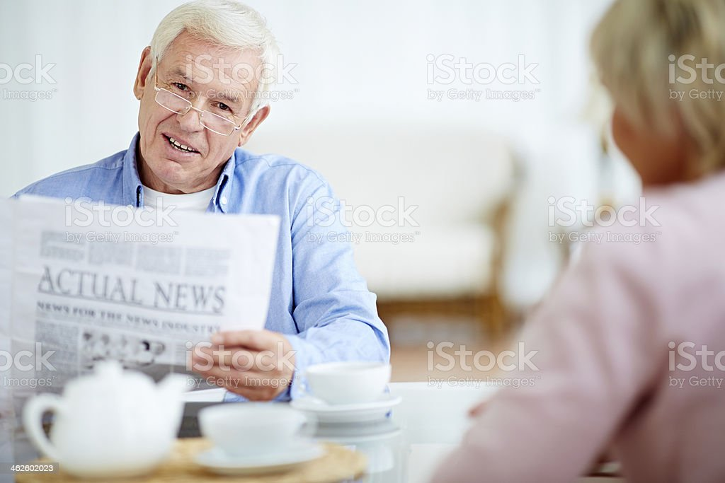 Reading actual news royalty-free stock photo