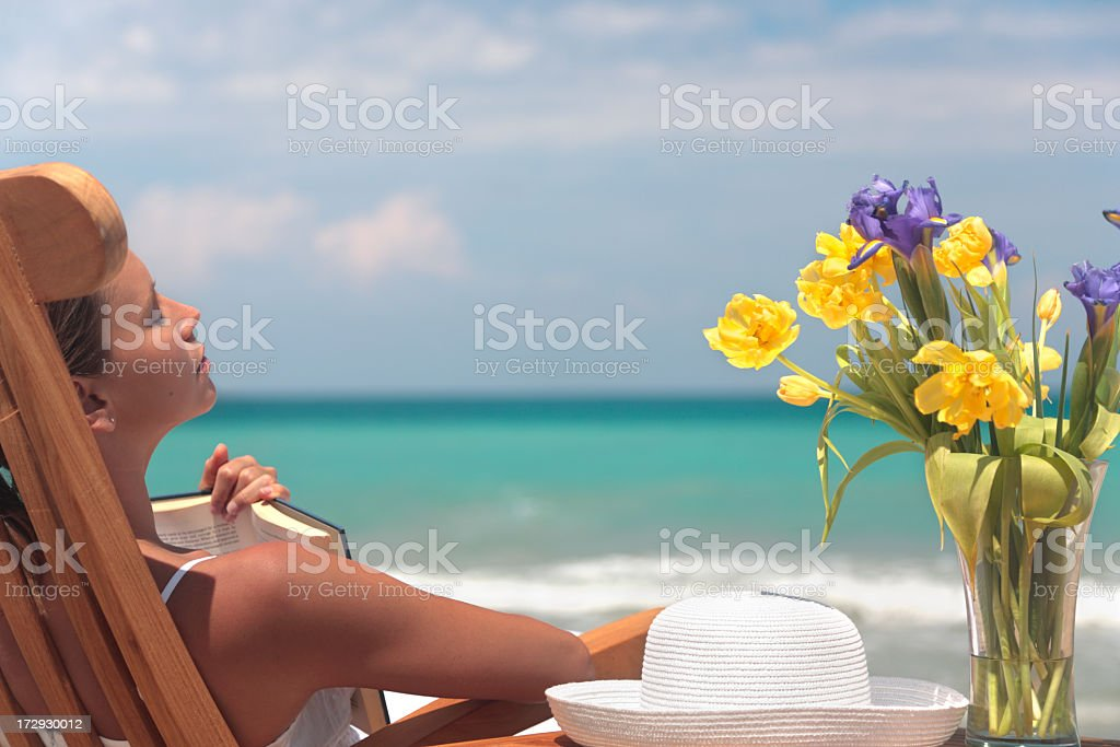 reading and flowers royalty-free stock photo