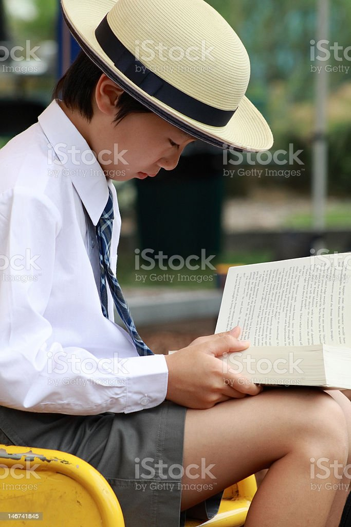 Reading and waiting school bus stock photo