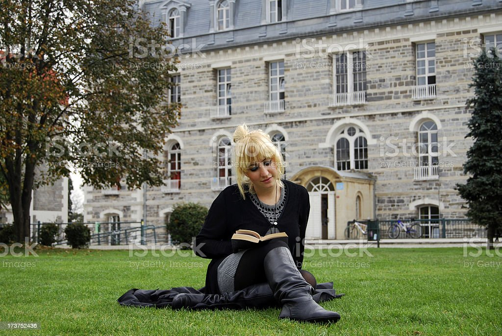 reading at campus royalty-free stock photo