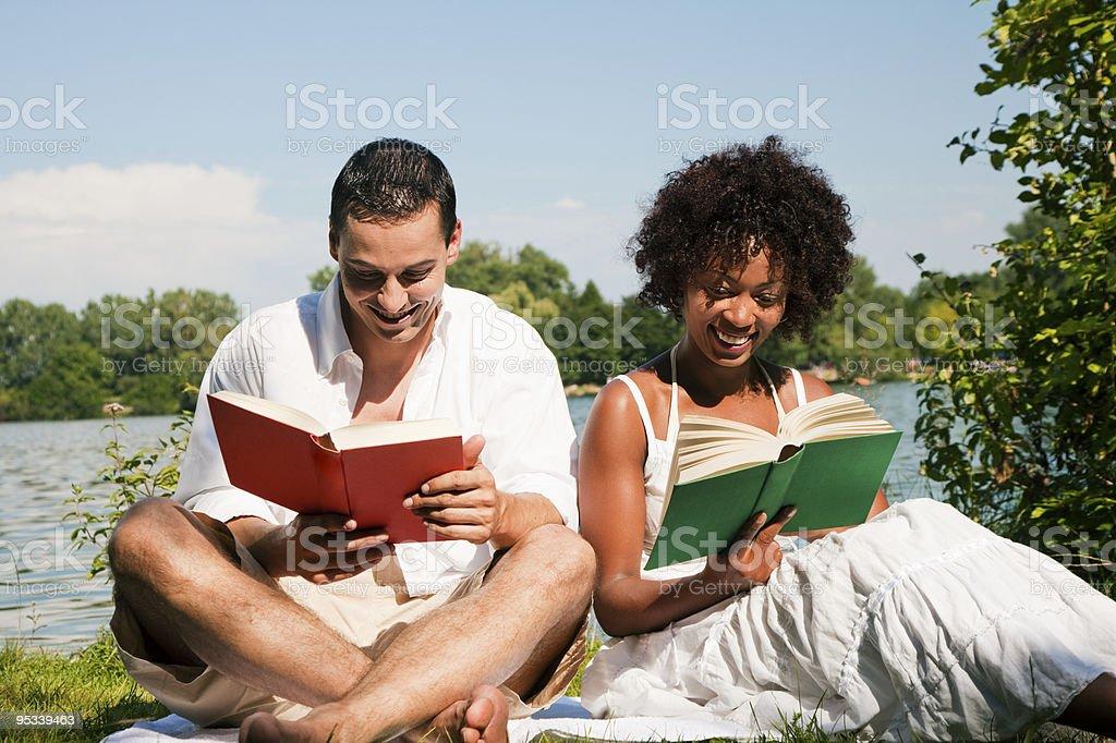 Reading at the lake royalty-free stock photo