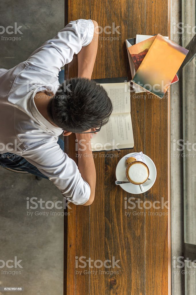 Reading book is a good way to improve knowledge stock photo