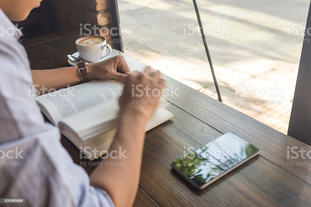 Reading book regularly is a good habit stock photo