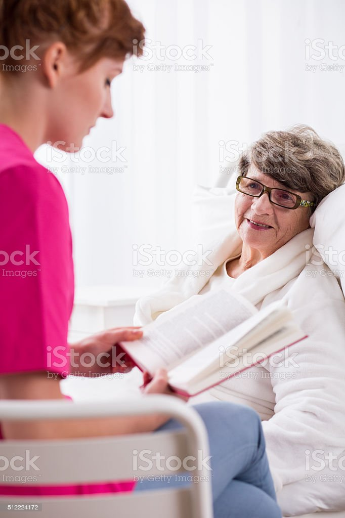 Reading book to patient stock photo